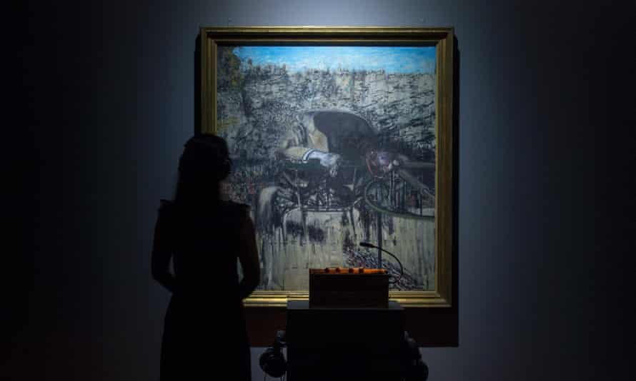 A woman experiences Francis Bacon's Figure in a Landscape at the Tate Sensorium