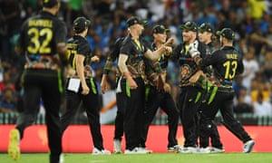 Daniel Sams celebrates catching Virat Kohlifor 85 as Australia beat India by 12 runs.