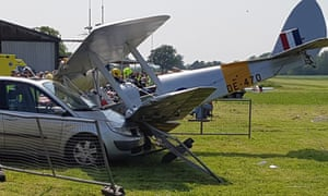Tiger Moth biplane crashes into a car at Brimpton airfield in Berkshire.