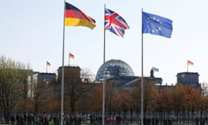 European Union, British and German flags flutter in front of the chancellery to mark Theresa May's visit.