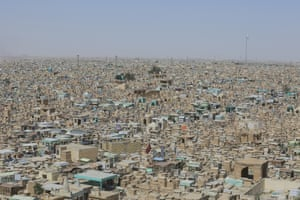 Najaf, Iraq. A view of the Valley of Peace (Wadi-al-Salaam) which hosts 6 million graves. Some tombs are arranged as houses, some look like cupolas and others look like miniature mosques