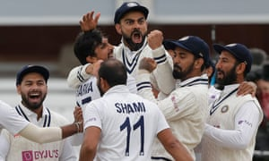 Virat Kholi celebrates with Ishant Sharma after reviewing and getting Jonny Bairstow out LBW.