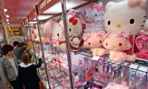 Hello Kitty dolls are overcrowdedly displayed on a shelf at a toy store in Tokyo Monday, May 8, 2006.