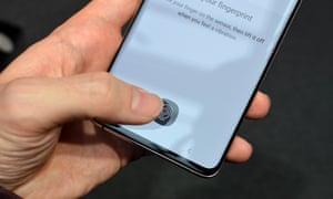 The ultrasonic scanner reads your fingerprint through the screen.