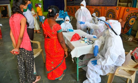 Patients share beds as coronavirus cases overwhelm Mumbai's hospitals