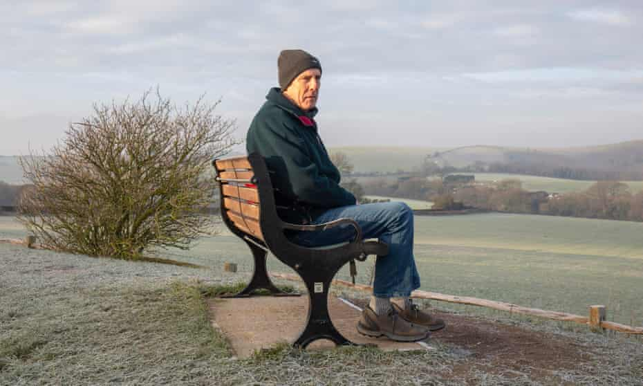 Walker David sitting on a bench on Clayton Hill, South Downs