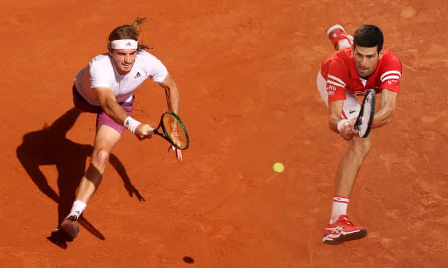 Stefanos Tsitsipas (left) has improved since the last time he played Novak Djokovic at the French Open.