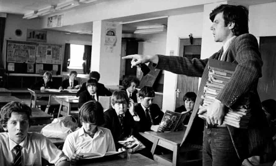 School teacher taking a lesson in a classroom, circa 1970.