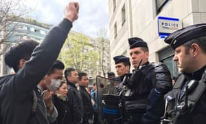French police face off with members of the Chinese community during a protest outside a police station in Paris