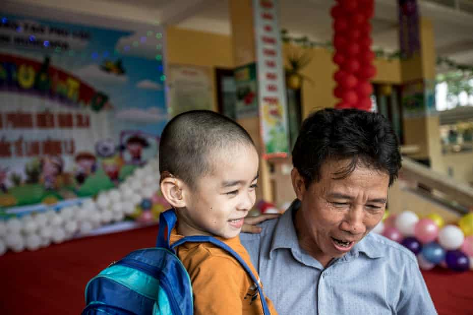 Ho Duc Luc collects his son from school in Lộc Bổn commune, Phú Lộc district.