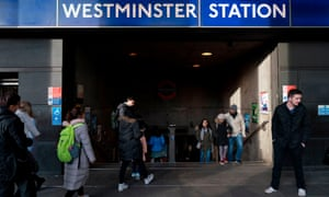 Passengers enter and leave Westminster Underground station