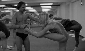 Bikram Choudhury assists actress Carol Lynley at his yoga studio in Beverly Hills, California.
