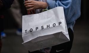 A shopper with a Topshop bag