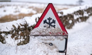 An ice warning sign is covered with snow in Lancaster in February 2018.