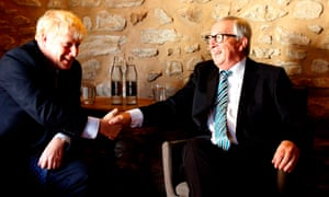 Jean-Claude Juncker (right) shakes hands with Boris Johnson
