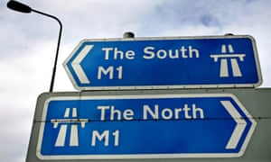 A sign at Junction 26 of the M1 motorway pointing north and south.