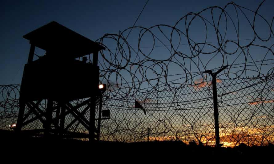 The sun sets on Camp X-Ray in Guantánamo Bay where the men were taken.