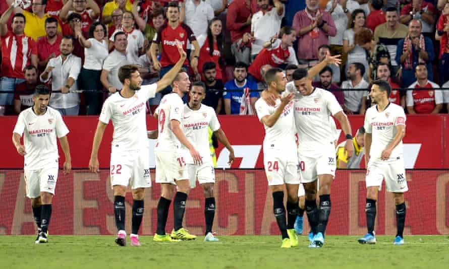 Sevilla's midfielder Mudo Vazquez (second left) celebrates his winner
