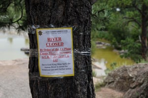 Signs posted along the river proclaim it closed by order of the La Planta County sheriff's office to all forms of recreation until further notice