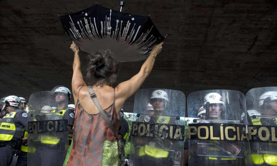 A demonstrator protests over the lack of water in front of riot police in São Paulo's central Paulista Avenue in February 2015.