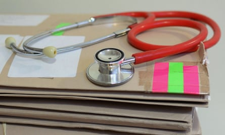 Stethoscope on top of patient's files
