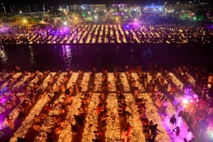 Earthen lamps are placed on the banks of the Sarayu River in Ayodhya, Uttar Pradesh, India
