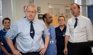 Boris Johnson visits the North Manchester General Hospital in Manchester with Matt Hancock (right).