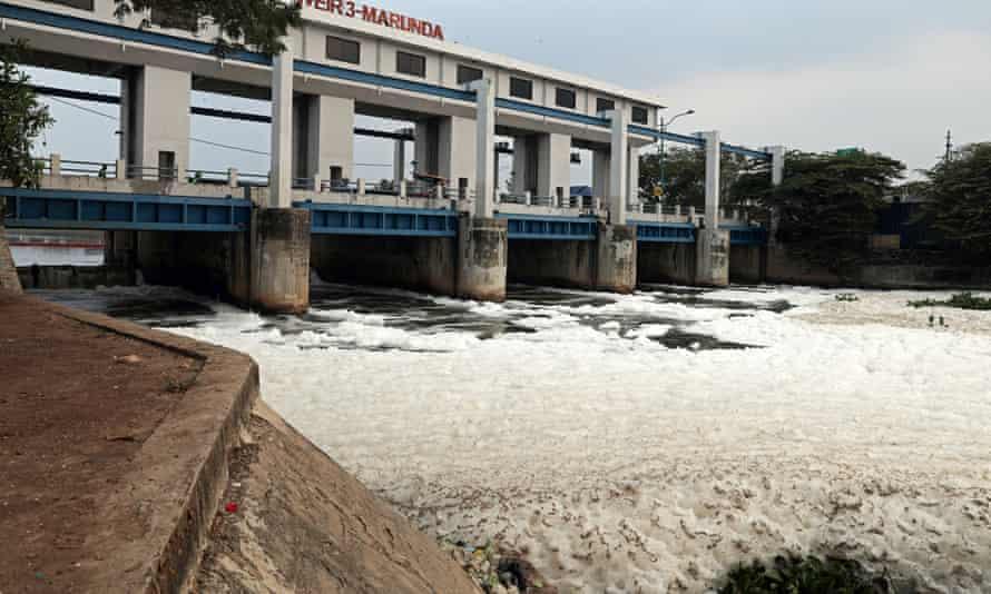 Foaming waste spills from the Marunda sluice gate in Jakarta.