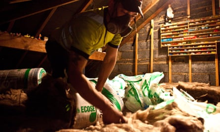 Sustainable loft insulation made from wool being installed in a roof in Kirklees, UK