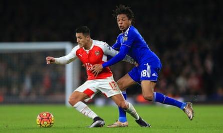 Chelsea's Loic Remy battles with Santi Cazorla of Arsenal