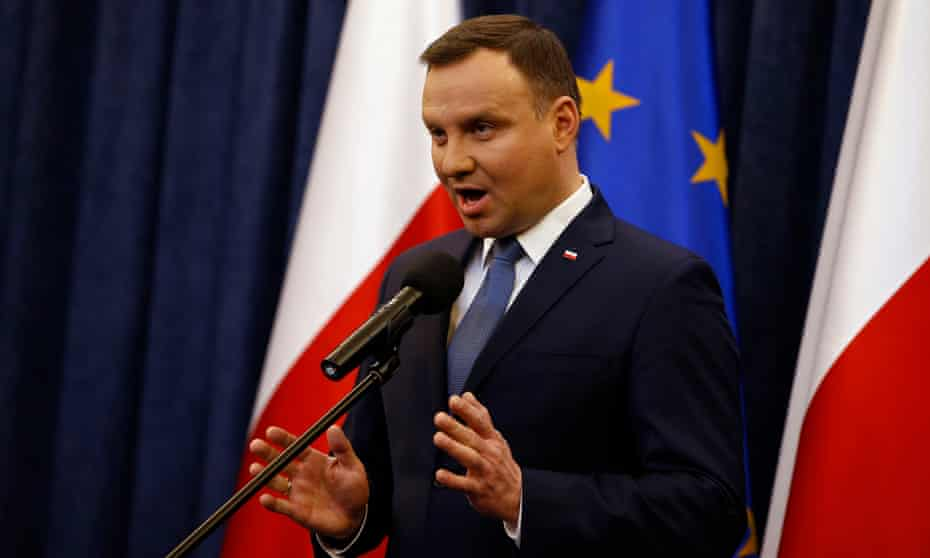 President Andrzej Duda speaking after he signed into law new rules for the constitutional tribunal.