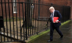 Boris Johnson walks out of Downing Street on 23 January