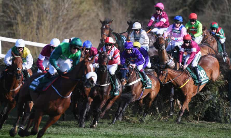 Ucello Conti leads the field at the Canal Turn in Saturday's Grand National.