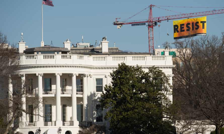 The Greenpeace banner behind the White House.