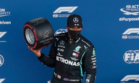 Lewis Hamilton poses with the pole position award for the Russian F1 GP