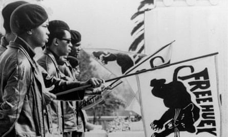 A group of flag bearing Panthers are shown outside the Alameda County Court House, Oakland, California, in August, during the Huey Newton trial. (AP Photo/S.F. Chronicle)