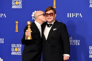 Bernie Taupin and Sir Elton John, winners of the best original song award for (I'm Gonna) Love Me Again, from Rocketman