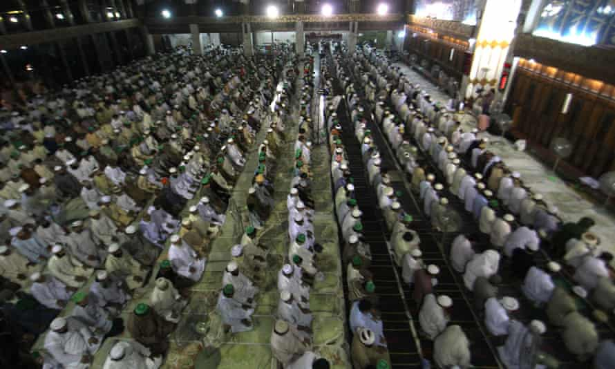 Pakistani faithful muslims offering Namaz-e-Taraweeh