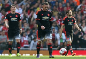 Bastian Schweinsteiger, Wayne Rooney and Daley Blind with heads down for Manchester United.