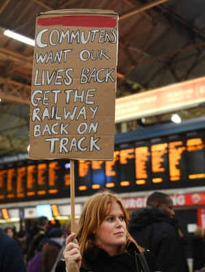 A commuter protests in support of Southern Rail staff. at Victoria Station in London.