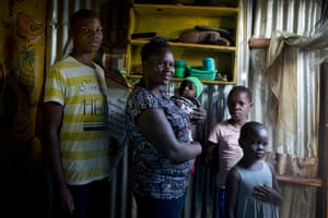 From left: Faizun Omondi, 15, Cody Achieng (mother) Aswin Gary (baby) Chelsea Dina, 9, and Denellythar June, 8 pose in their home in Kibera,