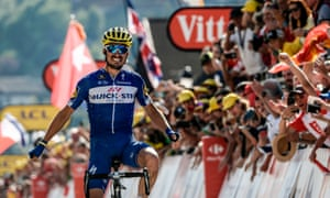 France's Julian Alaphilippe celebrates as he crosses the finish line to win the 10th stage of the Tour de France.