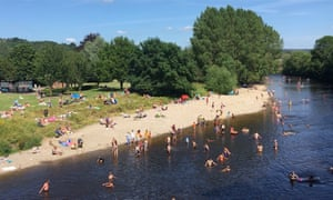 People out swimming, paddling and playing in the River Wharfe