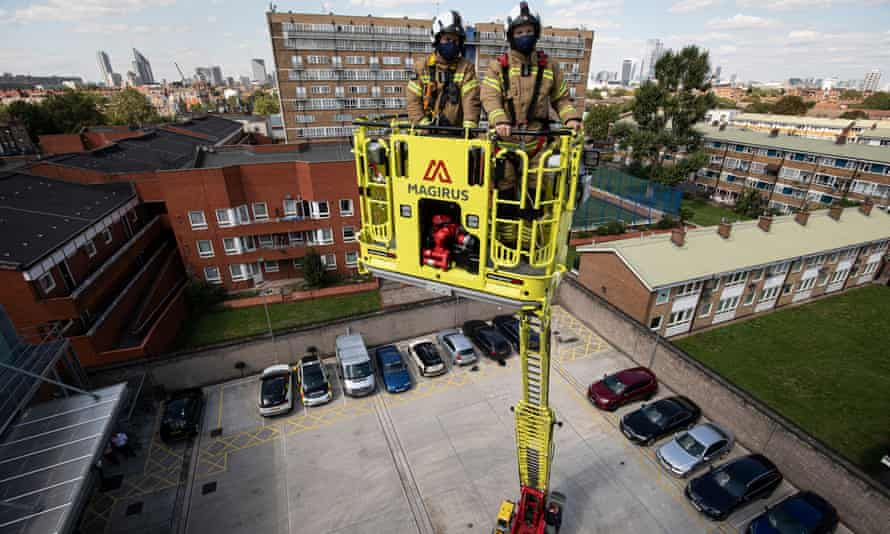 The LFB commissioner, Andy Roe (R), on a new 32-metre ladder and fire engine