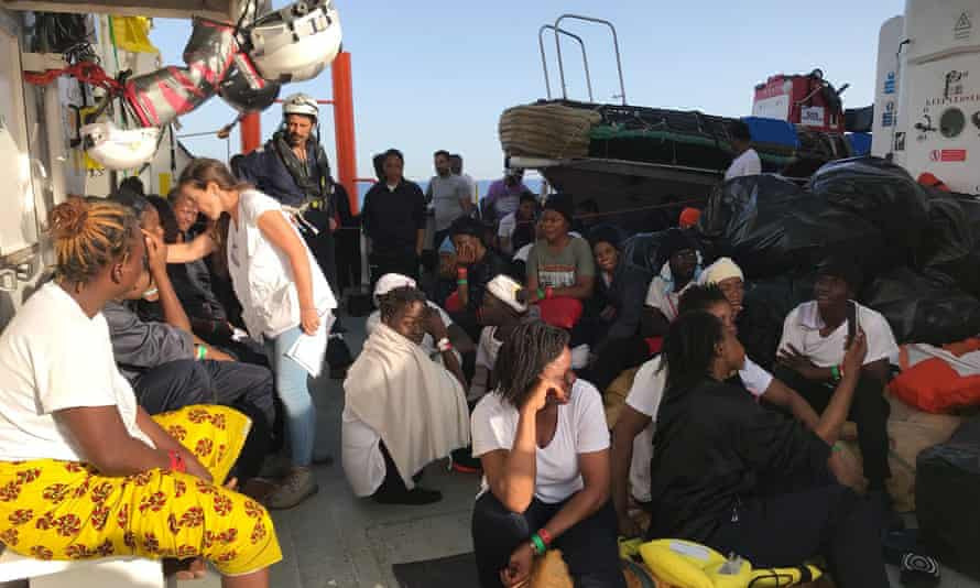Rescued migrants on an Italian coastguard ship after their transfer from Aquarius.