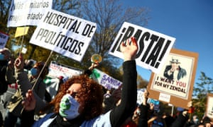 Health workers protest outside the new Enfermera Isabel Zendal hospital during its inauguration in Madrid, Spain