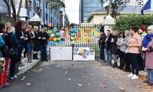 Activists hold vigil at an entrance gate to the Indonesian consulate general in Melbourne.