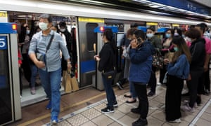 People wear face masks at a Mass Rapid Transit train station in Taipei, Taiwan, 24 October 2020.