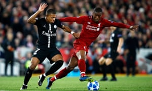 Kylian Mbappé challenges Georginio Wijnaldum during PSG's Champions League defeat at Anfield in September 2018