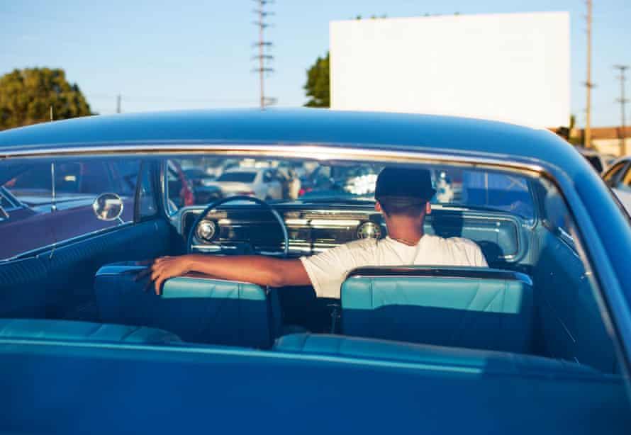 man in car seen from rear
